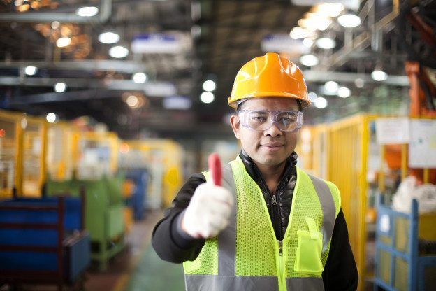 Construction worker giving the camera a thumbs up