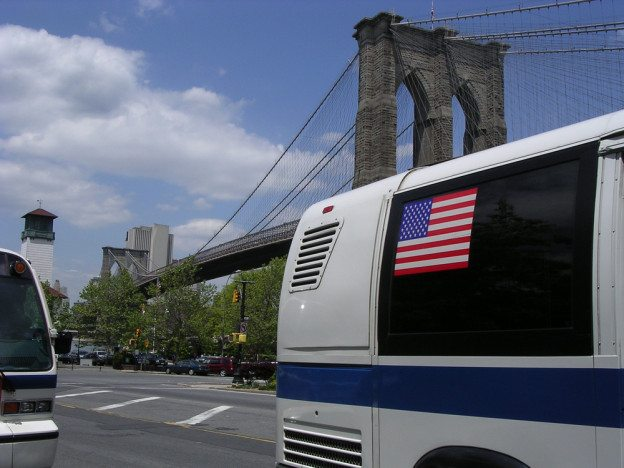 MTA Buses with Brooklyn Bridge in background