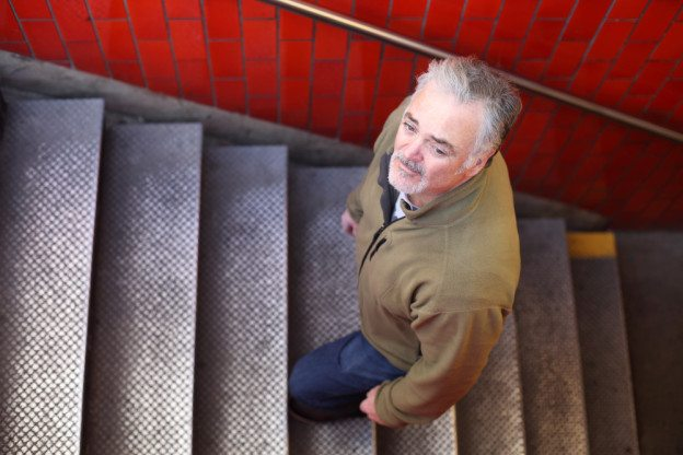 Mature man climbing subway steps