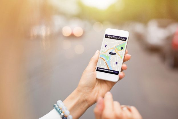 Woman using ride sharing app