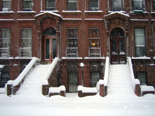 Snowy brownstone stairs in Brooklyn NY