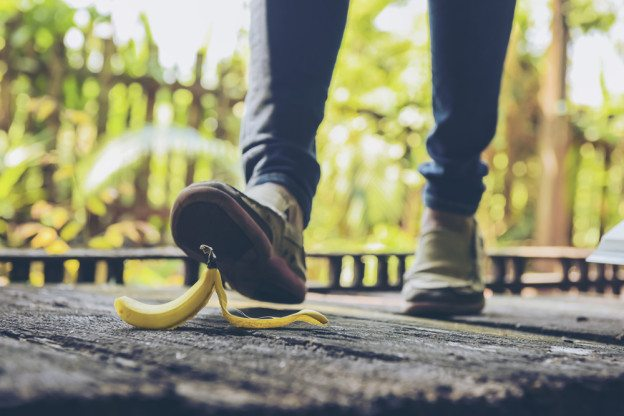 Women at risk of slipping on banana peel