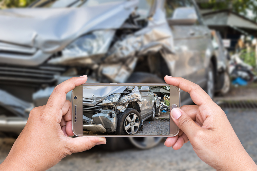 Victim of car accident takes photos of the damages