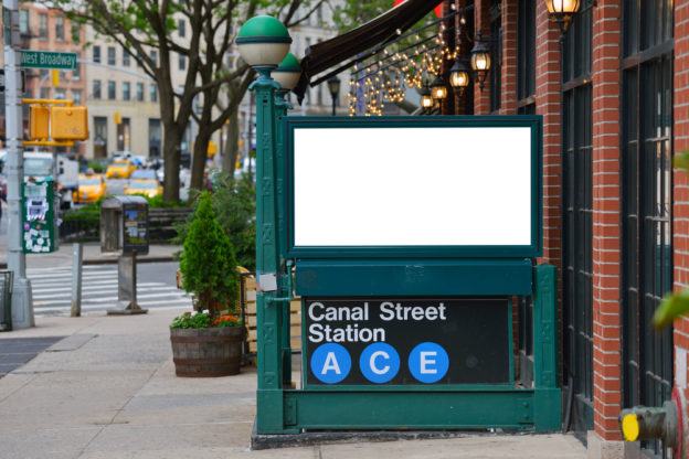 Blank billboard on canal street subway entrance