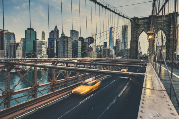 taxi cab speeding over the brooklyn bridge