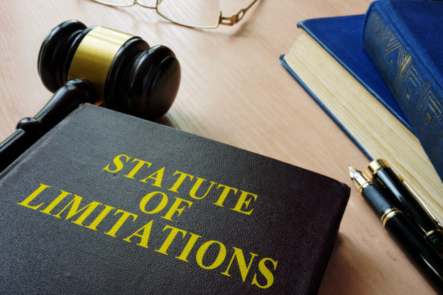 statute of limitation law book on a table