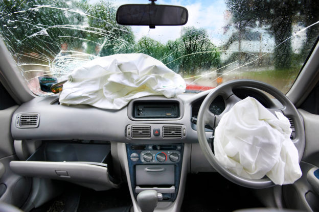 airbag and cracked wind shield after car accident