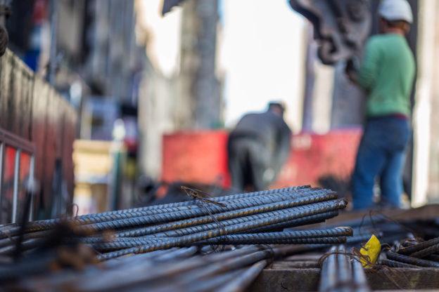 Construction worker handling rebar in New York City