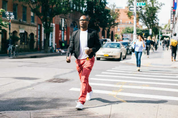 man walking down street with coffee in NYC