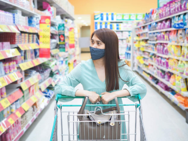 young female walking in a convenient store